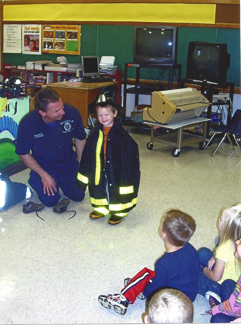Belleville Fire Department teaches a young child about the rigors of firefighting.